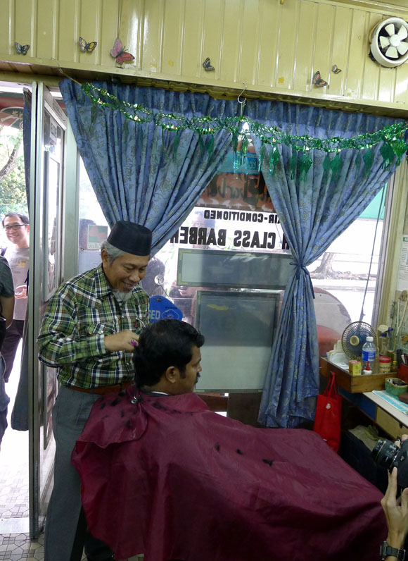 old Malay barber at work