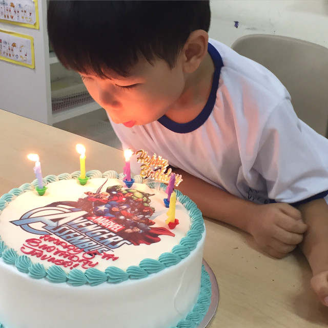 JJ_boy blowing candle