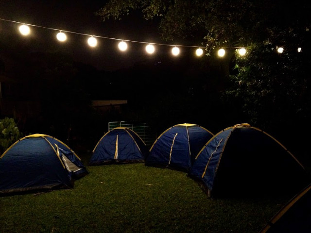 camping in tents by night
